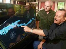 "Jefferson Project Director Rick Relyea (left) and IBM Research Distinguished Engineer Harry Kolar (right) examine a visualization of Lake George, as part of The Jefferson Project at Lake George, a three year effort to deploy Internet of Things technology to create the ""world's smartest lake."""