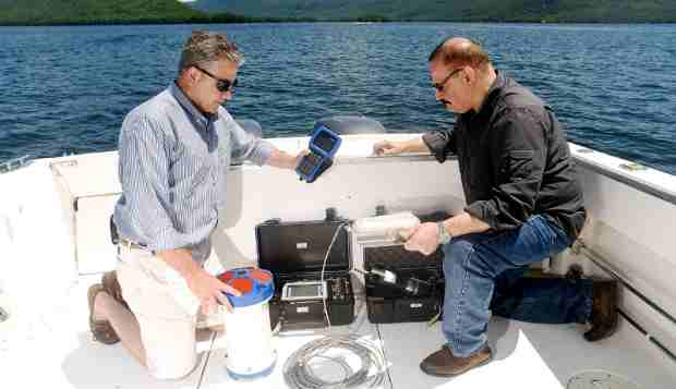 "IBM Research scientists Mike Kelly (left) and Harry Kolar (right) deploy an array of sensors that capture data which will be analyzed to help manage and protect New York's Lake George. Their efforts are in support of The Jefferson Project at Lake George, a three year research initiative to deploy Internet of Things technology to create the ""world's smartest lake."""