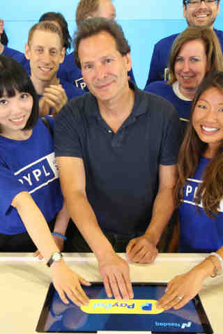 PayPal President and CEO Dan Schulman joins employees and customers to push the iconic PayPal button to ring the bell at Nasdaq