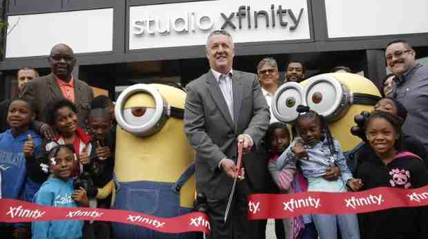 The Minions joined Comcast regional senior vice president John Crowley to cut the ribbon at the grand opening of STUDIO XFINITY in Chicago