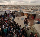 Syrian refugees crowd around an office in Domiz refugee camp in the Kurdistan Region of Iraq. Photo: OCHA