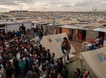 Syrian refugees crowd around an office in Domiz refugee camp in the Kurdistan Region of Iraq. Photo: OCHA