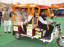 Narendra Modi taking a ride on e-Rickshaw, on the launch of 'Stand up India' programme, in Noida, Uttar Pradesh on April 05, 2016