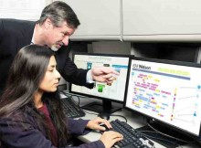 IBM's Chief Watson Security Architect Jeb Linton demonstrating to University of Maryland Baltimore County student Lisa Mathews how to teach IBM's Watson the language of security, Tuesday, May 10, 2016.