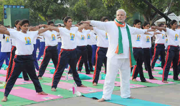 Narendra Modi Playing Yoga Tricks. Photo: Press Information Bureau