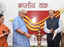 Manoj Sinha lighting the lamp to inaugurate the Dak Help Line, in New Delhi on September 12, 2016