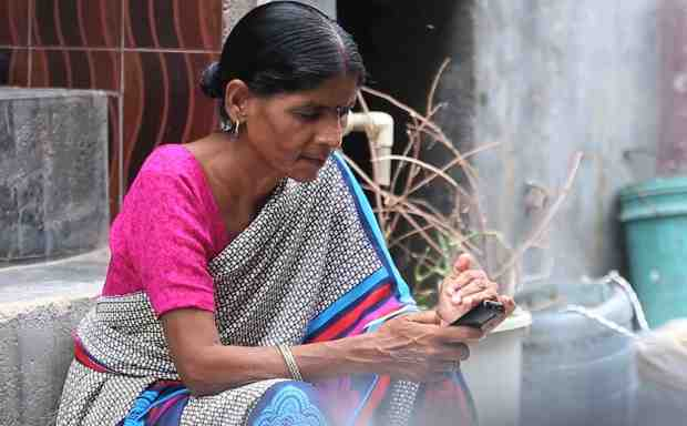 New apps from Accenture Labs and Grameen Foundation India use AI and AR technology to increase adoption of financial services.