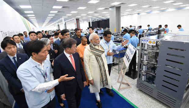 The Prime Minister, Narendra Modi and the President of the Republic of Korea, Moon Jae-in taking a tour of mobile factory in Noida, Uttar Pradesh on July 09, 2018