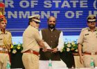 """The Delhi Police Commissioner, Shri Amulya Patnaik presenting a memento to the Minister of State for Home Affairs, Shri Hansraj Gangaram Ahir, during the """"Cyber Safety and Digital awareness programme for senior citizens"""", in New Delhi on July 05, 2018."""