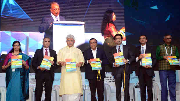 Manoj Sinha releasing the publication, at the inauguration of the India Mobile Congress - 2018, in New Delhi on October 25, 2018. The Secretary, (Telecom), Ms. Aruna Sundararajan and other dignitaries are also seen.