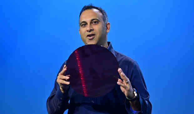 Navin Shenoy, Intel executive vice president and general manager of the Data Center Group, displays a wafer containing Intel Xeon processors during a keynote on Tuesday, April 2, 2019. Photo: Walden Kirsch / Intel