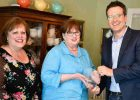 OnDeck CEO Noah Breslow joins Tea By Two co-owners Janet Meyers (l) and Erin Bradley (c) to celebrate the success of their small business in Bel Air, Maryland.