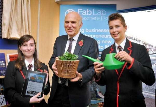Business Secretary is presented with a tweeting plant - made at Fab Lab Ellesmere Port by local teenagers Rachel O' Toole and Patric Rabsky.